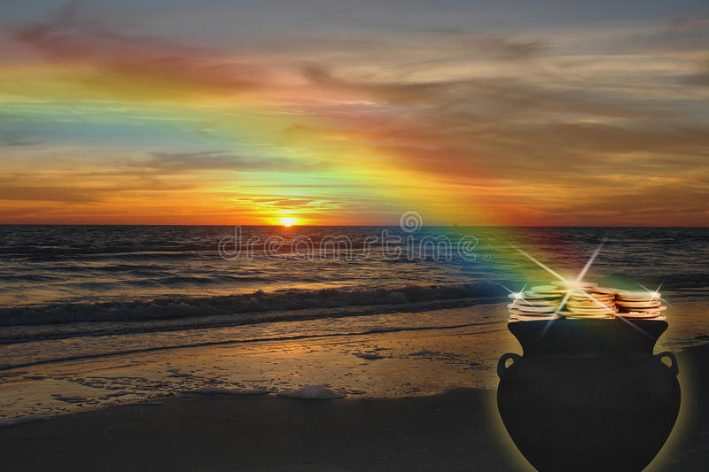 Pot of Gold. Mythical pot of gold at the end of the rainbow, at sunset on the beach stock image