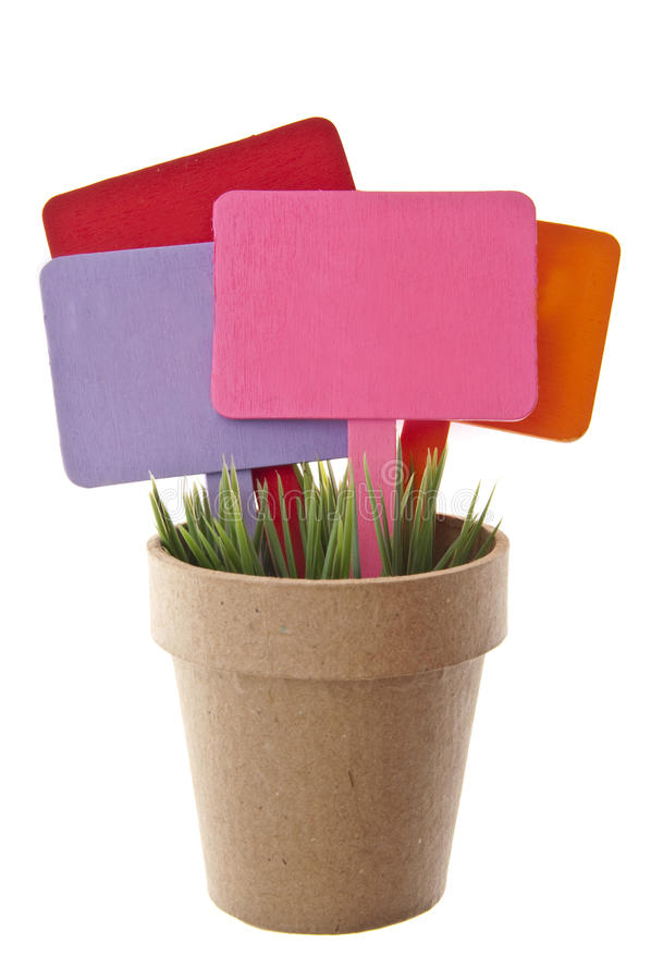 Download Pot Of Grass With Several Blank Colored Signs Stock Image - Image: 15488153