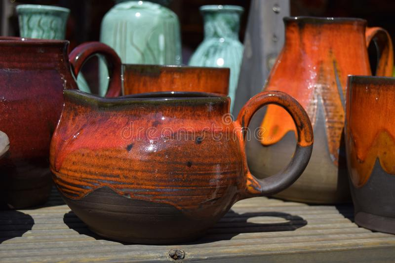 The pot is made of clay in ancient, vintage style. Ware is homemade. royalty free stock photography