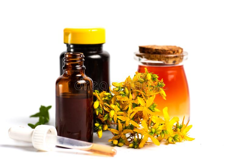 Pot marigold oil and flowers isolated. Calendula Pot marigold herbal essential oil and flowers isolated on white, bouquet, tincture, background, plant, petal royalty free stock photos
