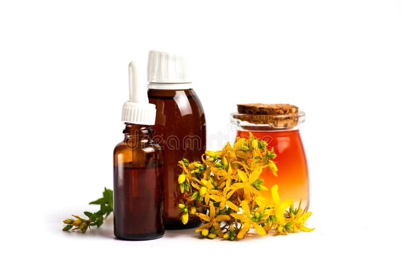 Pot marigold oil and flowers isolated. Calendula Pot marigold herbal essential oil and flowers isolated on white, bouquet, tincture, background, plant, petal stock photography