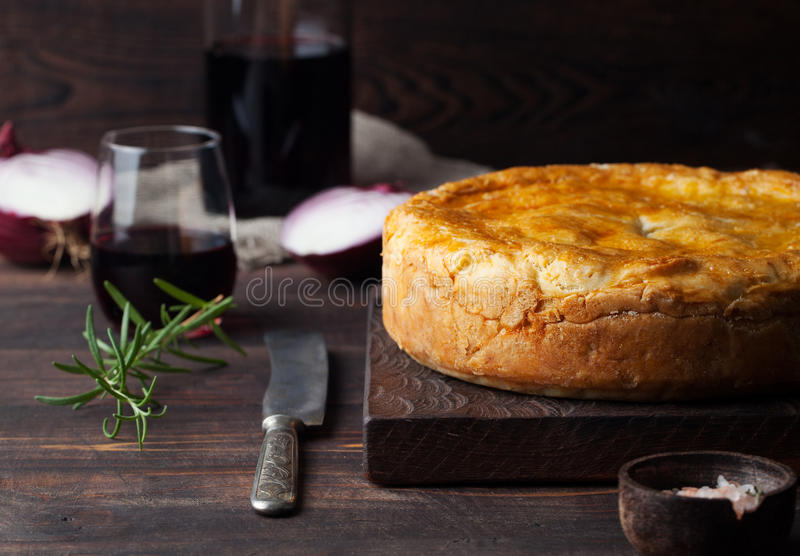 Pot Meat Pie with wine Wooden background stock photo