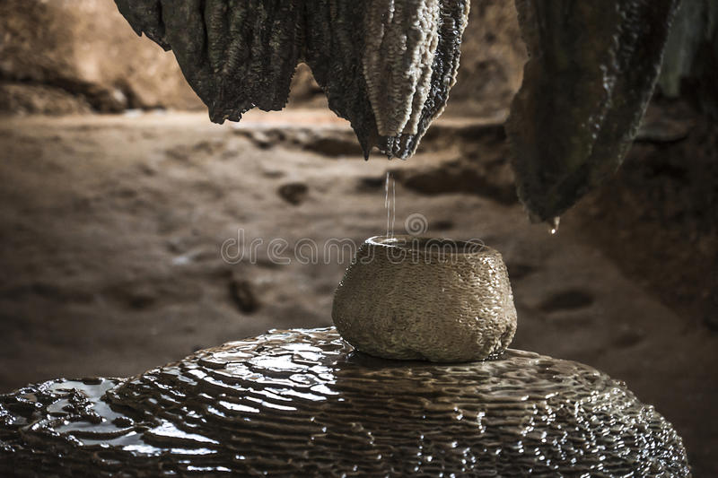 Pot in a meditation cave in Wat Tham Sua, Krabi, Thailand. Pot filled with water from stalactites in a meditation cave in Wat Tham Sua, Krabi, Thailand stock image