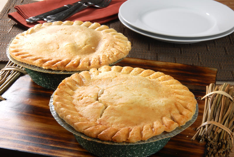 Pot pies cooling. Fresh baked pot pies cooling on a cutting board stock photography