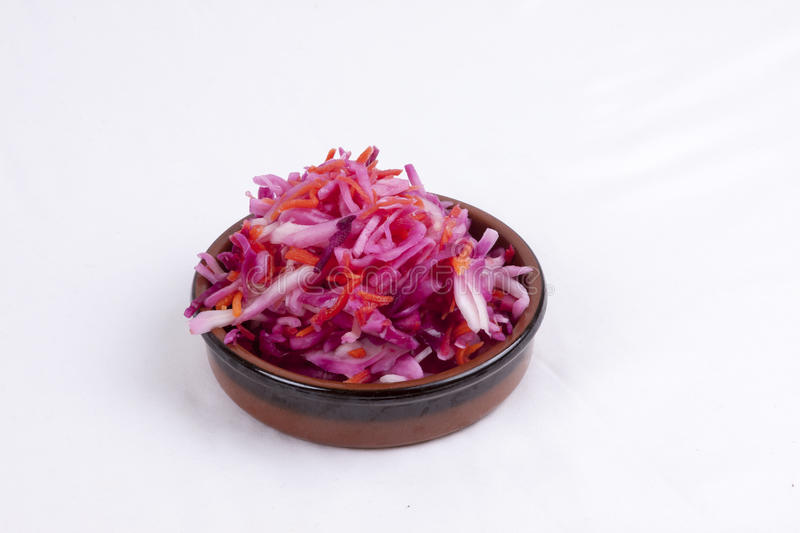 Pot of pink coleslaw. Photo of pot of pink coleslaw isolated on a white background royalty free stock images