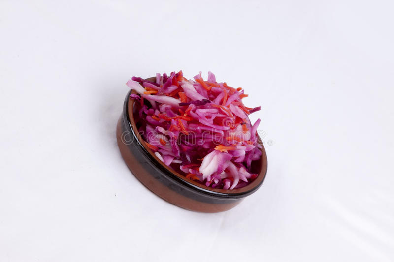 Pot of pink coleslaw. Photo of pot of pink coleslaw isolated on a white background royalty free stock photo
