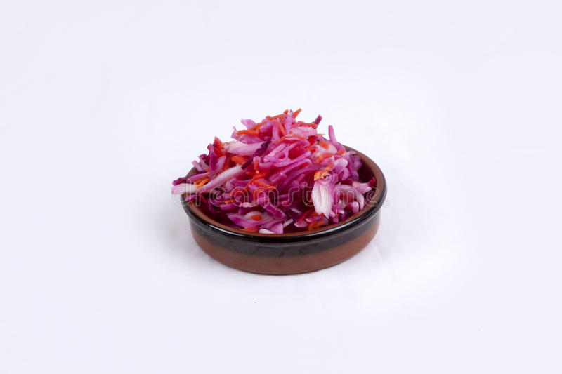 Pot of pink coleslaw. Photo of pot of pink coleslaw isolated on a white background royalty free stock image