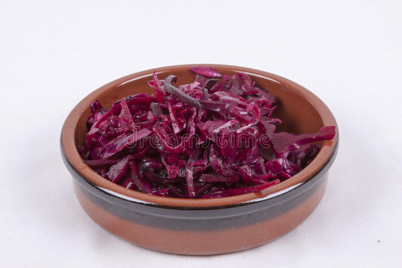 Pot of red coleslaw. Photo of pot of red coleslaw isolated on a white background stock photo