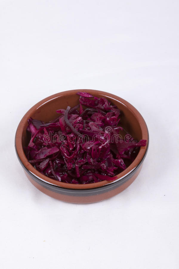 Pot of red coleslaw. Photo of pot of red coleslaw isolated on a white background royalty free stock photography