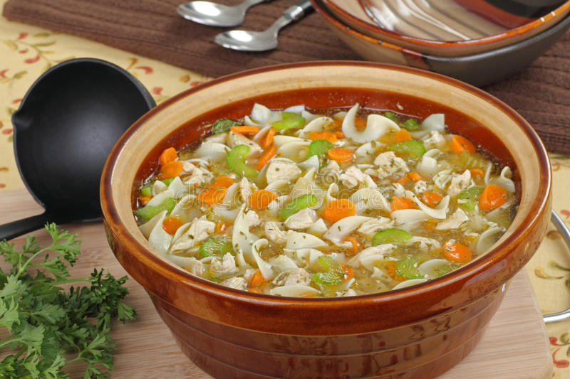 Pot of Soup. Pot of chicken and noodle soup with celery and carrots stock photos