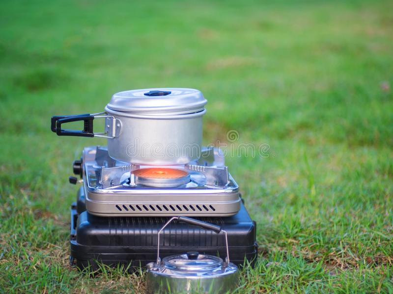 Pot stands on a portable gas stove. cooking on camping concept. stock images