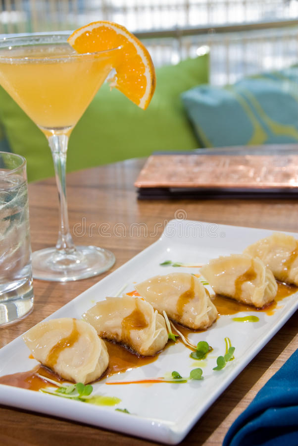 Pot Stickers With An Orange Martini Stock Images
