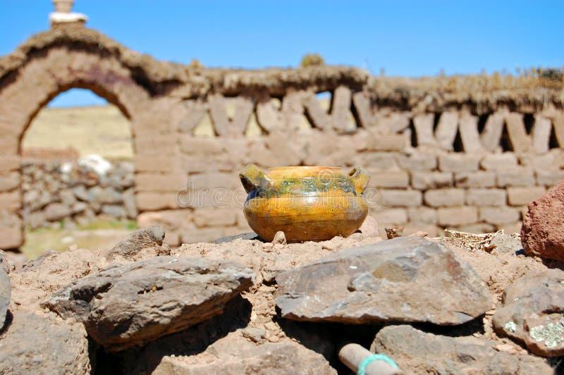 Pot on Stone Wall stock photo