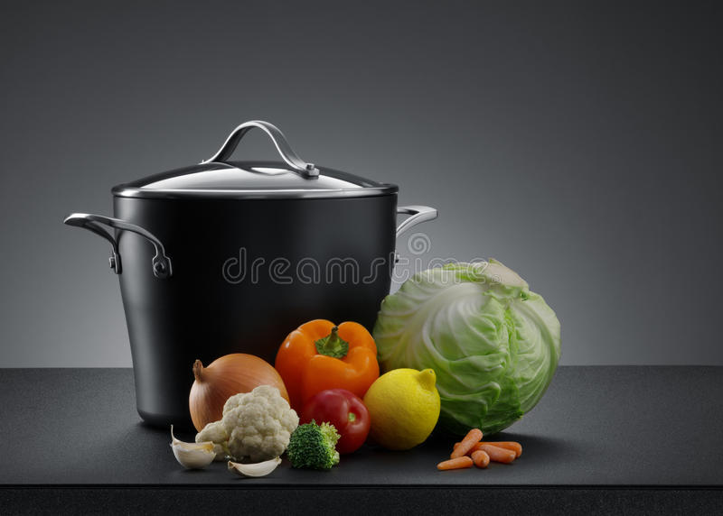 Pot and veggie royalty free stock photography