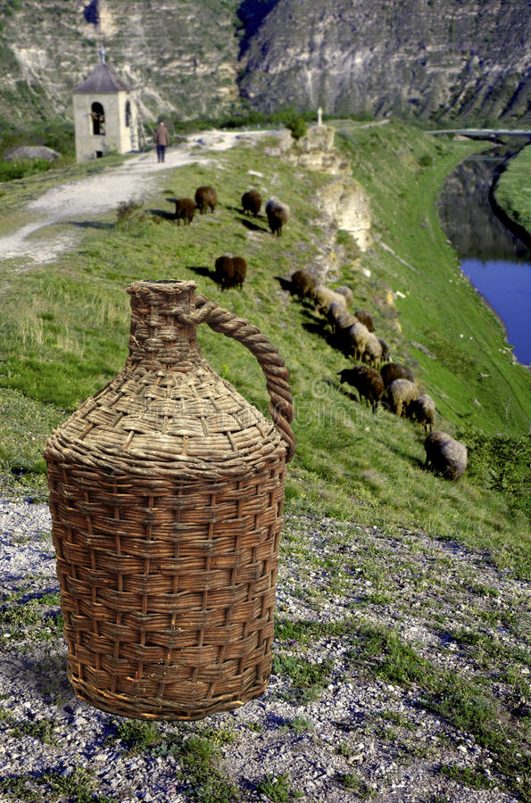 Pot of wine in front of moldavian landscape stock image