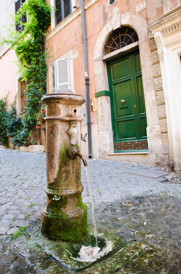 Potable fountain water in Rome. Known as NASONE stock photography