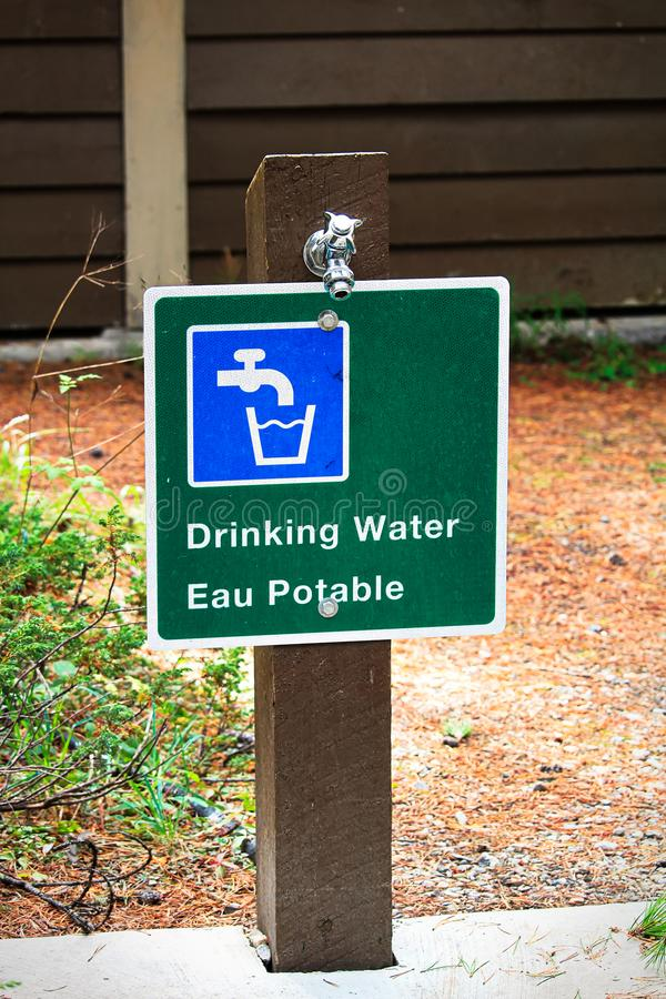 A potable water sign in both english and french.  stock image