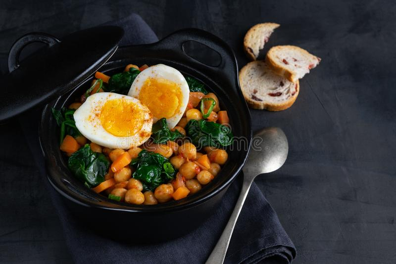 Potaje de Garbanzos chickpea stew Spanish recipe traditional with ingredients on a dark background with copy space. Horizontal. View from above royalty free stock photos