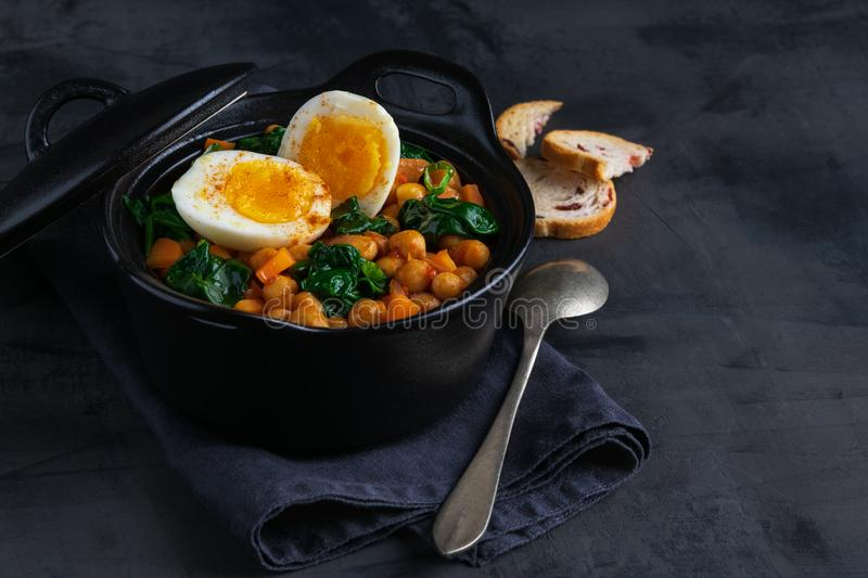 Potaje de Garbanzos chickpea stew Spanish recipe traditional with ingredients on a dark background with copy space. Horizontal royalty free stock photography