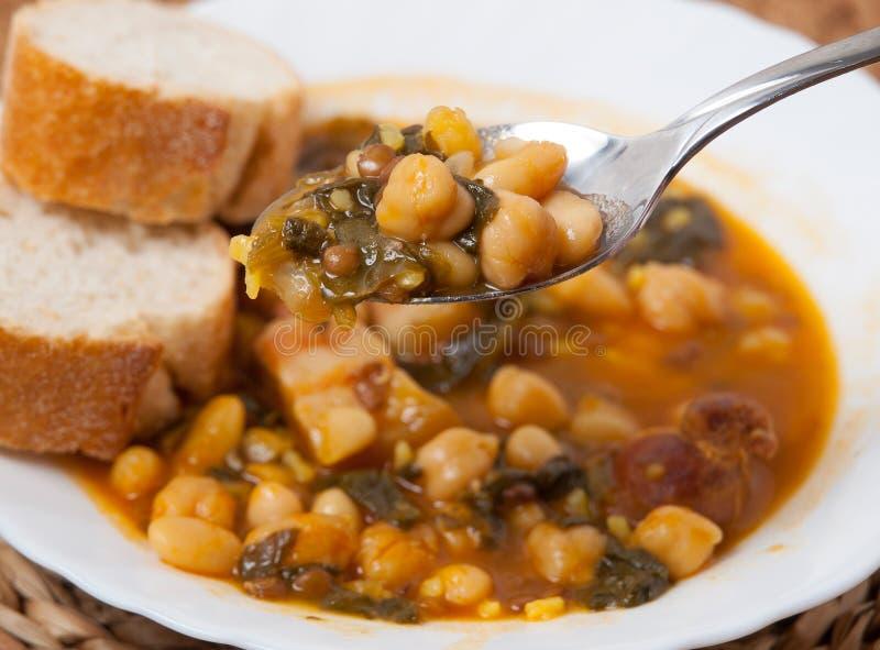 Potaje de Garbanzos y espinacas. Spanish cuisine. Stewed chickpeas with spinach. Image shows a full spoon stock photos