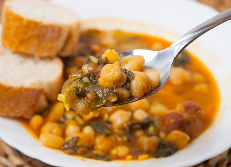 Potaje de Garbanzos y espinacas. Spanish cuisine. Stewed chickpeas with spinach. Image shows a full spoon royalty free stock photos