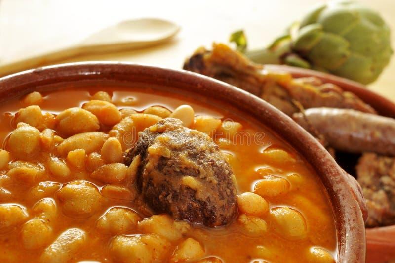Potaje de judias y garbanzos, a traditional spanish legume stew. An earthenware bowl with potaje de judias y garbanzos, a traditional spanish legume stew stock images