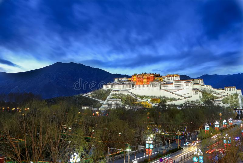 The potala palace in Lhasa. Street to the potala palace in Lhasa at night royalty free stock photos