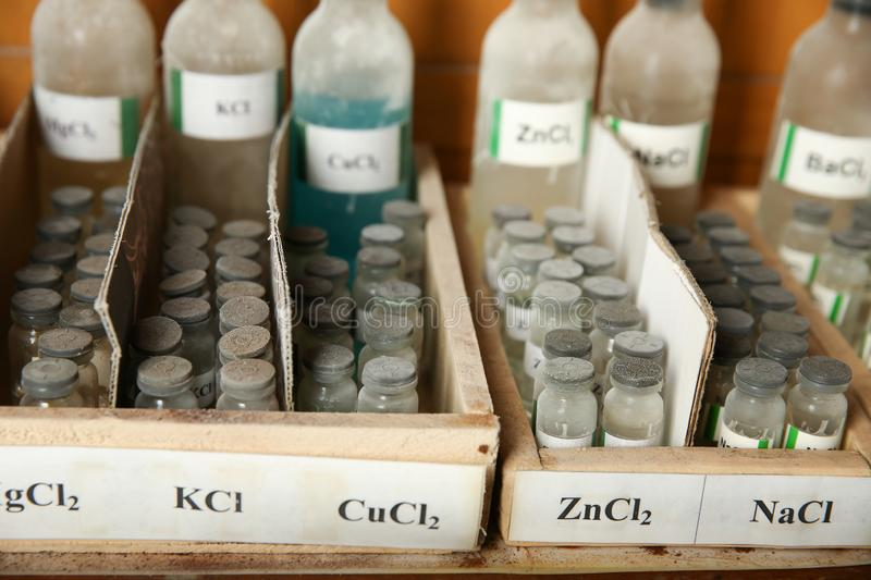 Potassium chloride, Copper chloride, Zinc chloride, Sodium chloride are in the bottels. Bottles with solutions of KCl, CuCl2, ZnCl2, NaCl on the shelf of the royalty free stock photography