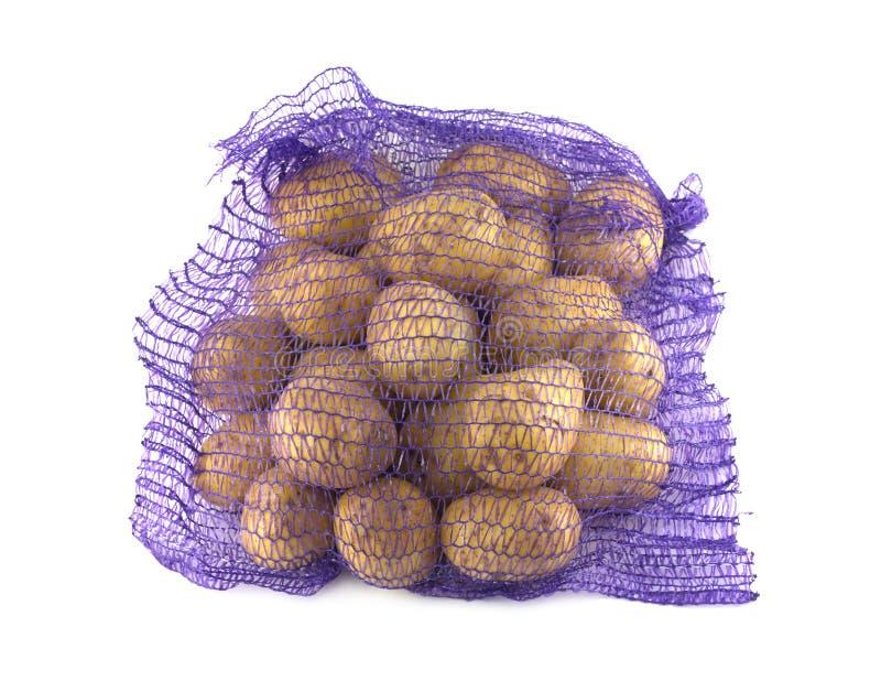 Potatisar inom isolerade closeupen för emballage den raster arkivbild