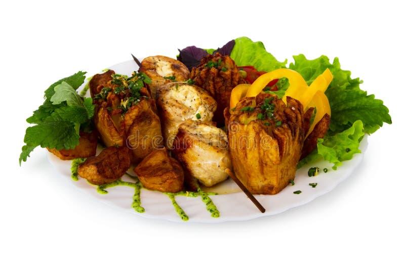 Potatisar och stekt kött royaltyfri foto