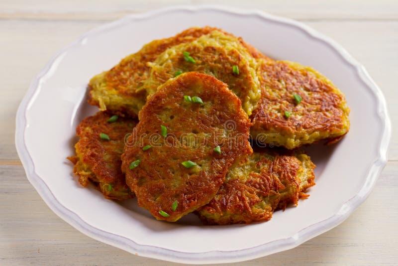 Potato Cakes. Vegetable fritters, latkes, draniki. Vegetable pancakes. royalty free stock photography