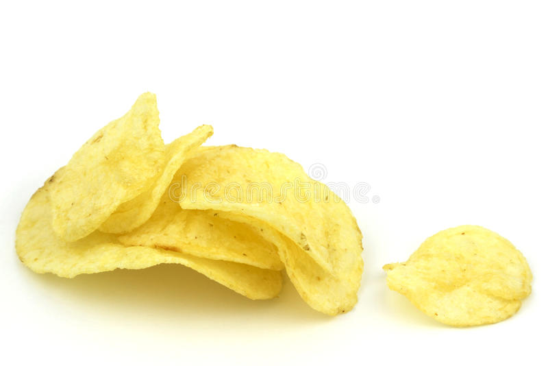 Potato chips. Crunchy golden potato chips isolated on white background with copy space royalty free stock photo