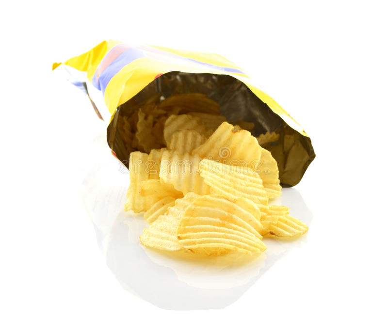Potato chips in bag on white background stock photography
