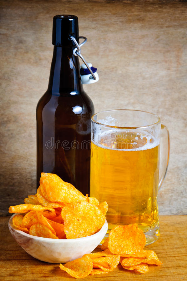 Potato chips and beer stock photo. Image of dinner, bottle ...