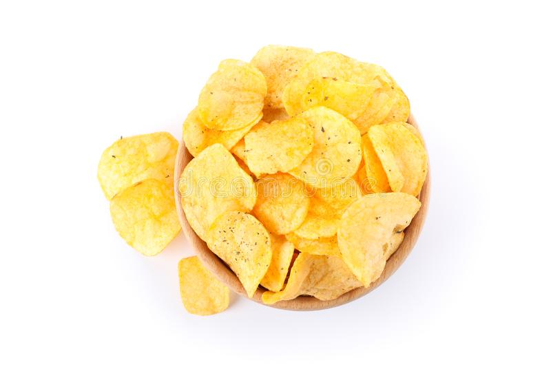 Potato chips in a bowl isolated on white background, space for text. Top view royalty free stock photo