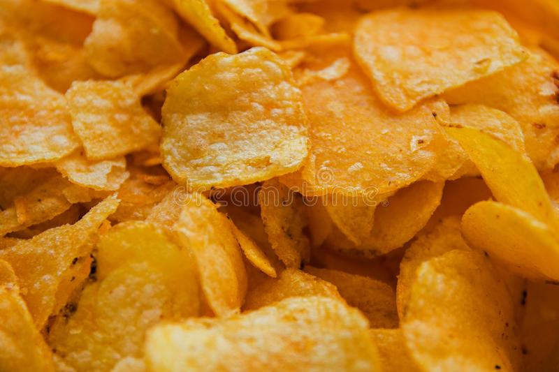 Potato chips harmful food background, close-up royalty free stock photos