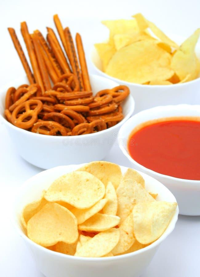 Potato chips, snacks and dip royalty free stock photos