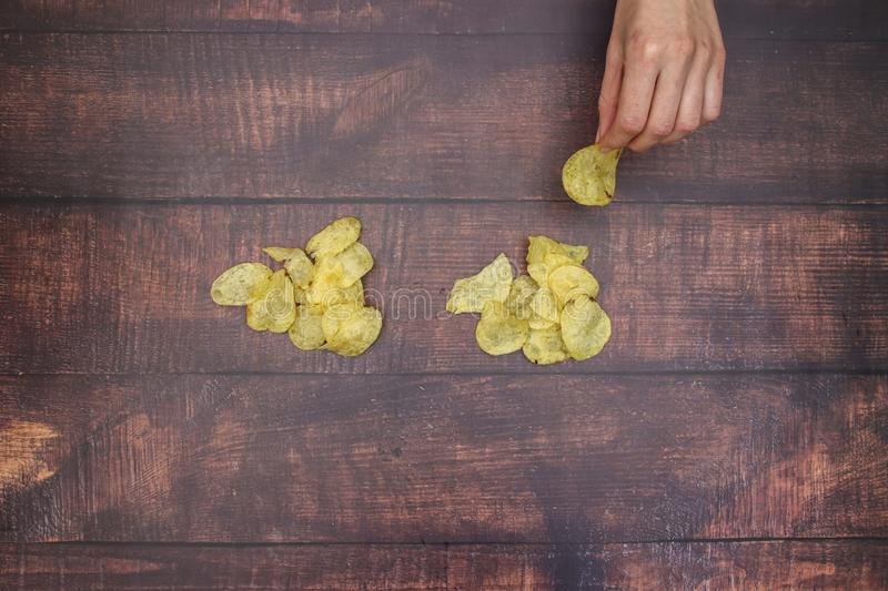 Potato chips on wooden table royalty free stock photography