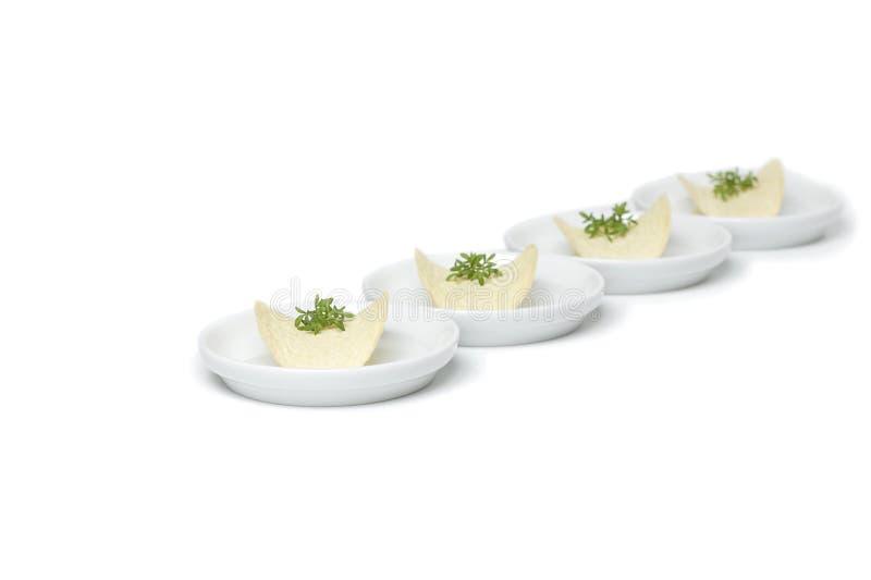 Potato crisps with herbs stock image