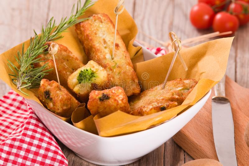 Potato croquettes with spinach and mozzarella. royalty free stock photo