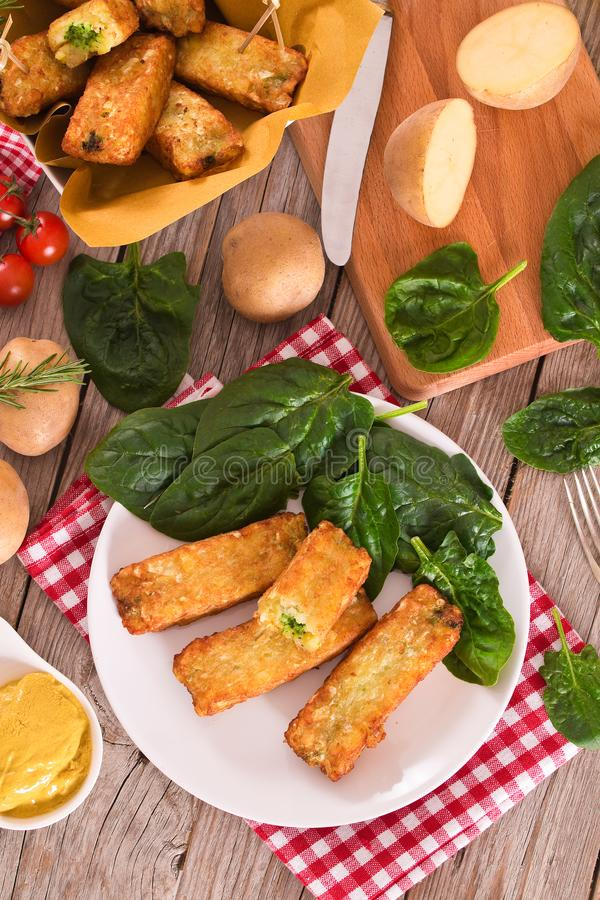 Potato croquettes with spinach and mozzarella. royalty free stock photos