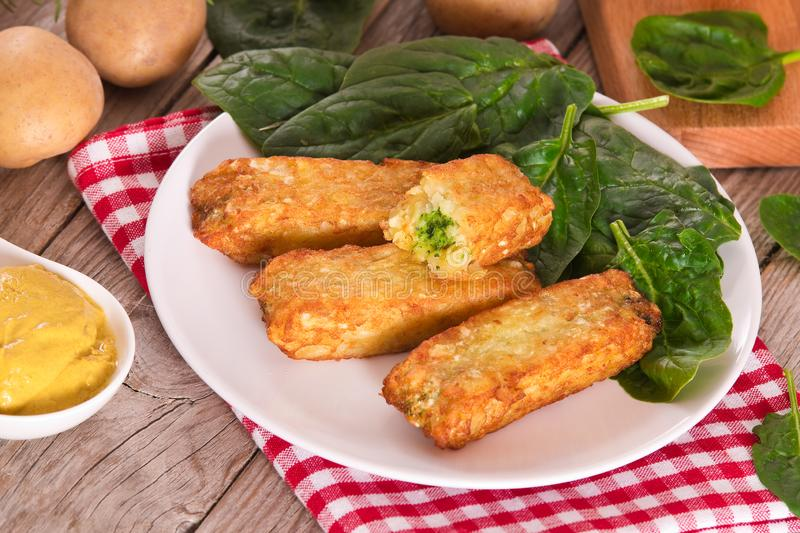 Potato croquettes with spinach and mozzarella. royalty free stock images