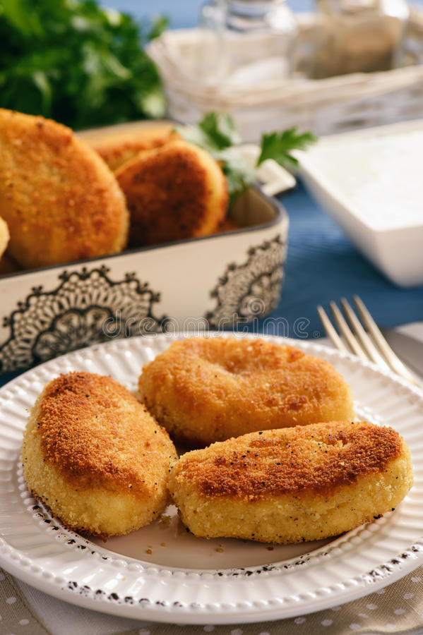 Potato croquettes stuffed with mozzarella and garlic sauce. royalty free stock images
