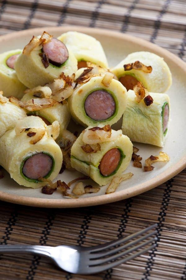 Potato dumplings. Still life of potato dumplings with sausage stock photos