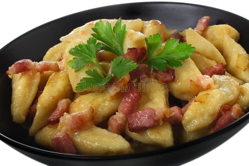 Potato dumplings. With fried bacon royalty free stock photo