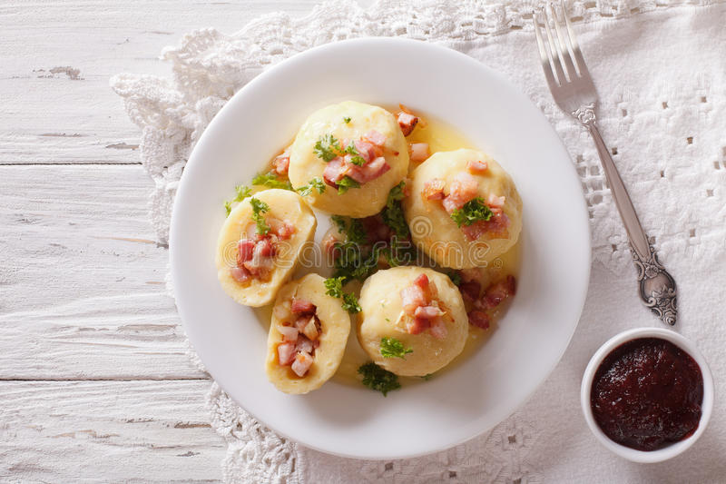 Potato dumplings stuffed with ham, bacon and onion close-up. horizontal top view. Potato dumplings stuffed with ham, bacon and onion close-up on a plate stock image