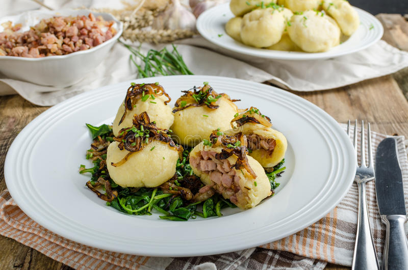 Potato dumplings stuffed with smoked stock image