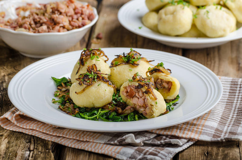 Potato dumplings stuffed with smoked. Meat, czech original meal, very unhealthy, but delicious royalty free stock photos