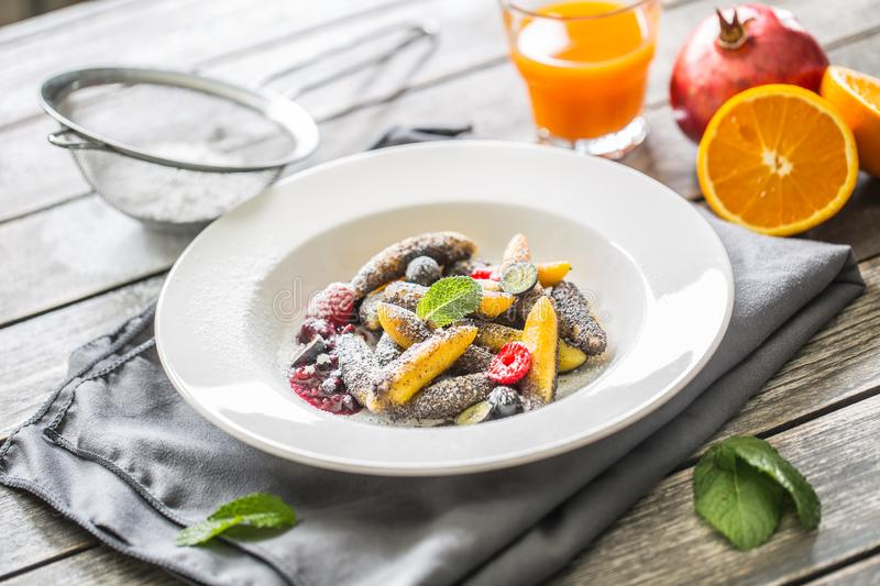 Potato dumplings sulance gnocci with milled poppy seeds shugar powder and marmalade. Traditional slovak czech and. Austrian sweet food stock image