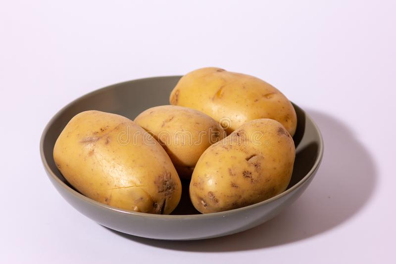 The potato is an edible tuber obtained from the plants of the species Solanum tuberosum, widely used for food purposes after cook stock photo